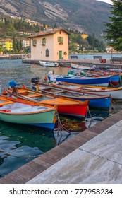 Berth with boats in the town of Riva del Garda. Italy. Pier in Riva del Garda.