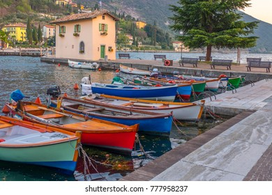 Berth with boats in the town Riva del Garda. Italy. Pier in Riva del Garda.