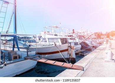 Berth for mooring fishing boats and yachts on the Mediterranean sea at dawn. Vrsar. Croatia