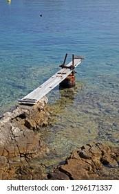 Berth for a vessel by a rocky shore near Mali Losinj, island Losinj, Croatia, Adriatic coast, Europe, 1