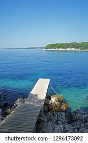 Berth for a vessel by a rocky shore near Mali Losinj, island Losinj, Croatia, Adriatic coast, Europe, 2