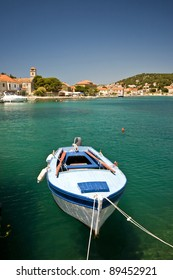 Berthed fishing boat in the emerald water