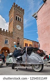 Bertinoro, Forli-Cesena, Emilia Romagna, Italy - June 14, 2014: vintage italian scooter parked in the central square near the clock tower during the rally Innocenti Day of Lambretta club Umbria