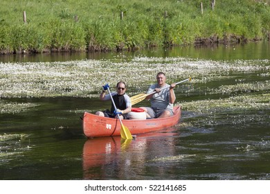 BERTRIX - BELGIUM - MAY 29, 2014: Canoeing men on the Semois river in the Ardennes