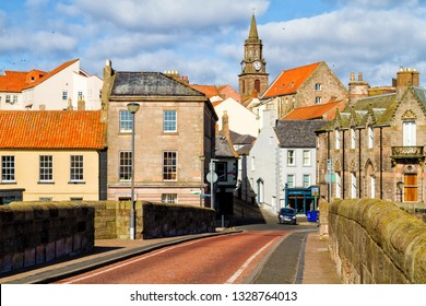 BERWICK-UPON-TWEED, ENGLAND - APRIL 3, 2018: High Street in town center of Berwick-upon-Tweed, northernmost town in Northumberland at the mouth of River Tweed in England, UK