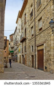 Besalu, Spain - April 23, 2018: Small street with old houses