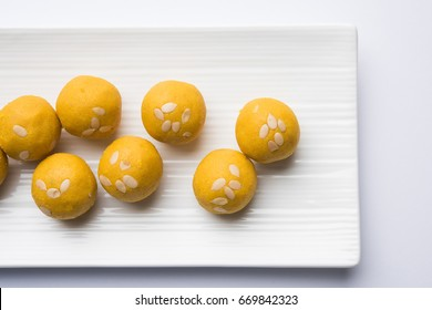 Besan Laddoo - Roasted gram flour mixed with Desi Ghee and sugar to make tasty and round shape sweet Laddu.Served in a plate. selective focus