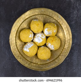 Besan Laddu Indian Traditional Sweet Food Also Know as Laddoos, laddoo, ladoo, laddo Are Ball-Shaped Sweets Popular in The Indian Festivals. Laddu on Black Textured Background