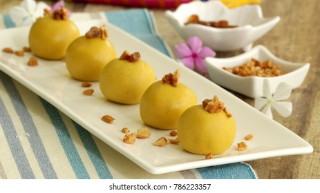 Besan ladoo is a popular sweet often prepared during festivals in Indian cuisine.