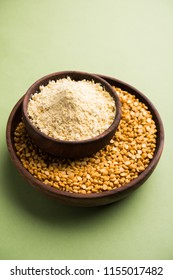 Besan powder, Gram or chickpea flour is a pulse flour made from a variety of ground chickpea known as Bengal gram. popular ingredient for Pakora/pakoda or bajji snack. Selective focus