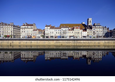 Besancon, France - The buildings of the Quai Vauban with their reflection in the Doubs River by a beautiful sunny day