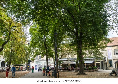BESANCONS, FRANCE/EUROPE - SEPTEMBER 13 : View of people in a square in Besancon France on September 13, 2015. Unidentified people