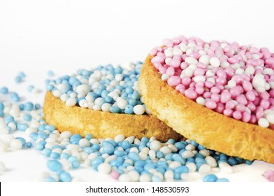Beschuit met muisjes for a girl and a boy. Traditional Dutch treat at the birth of a baby