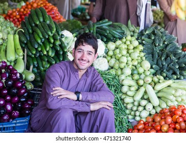 Besham, PAKISTAN - April 12, 2016: An unidentified Boy selling fruit and vegetables in a village of the Besham , Pakistan with a population of more than 150 million people.