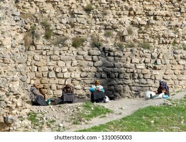 Beshbarmak rock, Quba-Khachmaz Region, Azerbaijan - March, 2008: Authentic Azerbaijani old women.