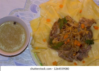 Beshbarmak - a traditional dish in Central Asia