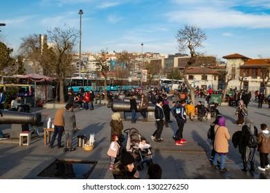 BESIKTAS, ISTANBUL, TURKEY- JANUARY 15, 2019: People sitting and sunbathing in park in Besiktas.