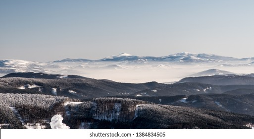 Beskid Zywiecki with Babia Gora and Pilsko hills from Lysa hora hill in Moravskoslezske Beskydy mountains in Czech republic during freezing winter day with clear sky