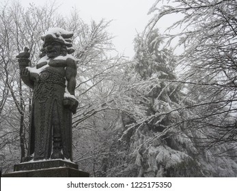Radhošť, Beskydy mountains / Czech Republic - 01 27 2018: statue of Radegast, slavic god of hospitality or war covered by snow in winter on mountain Radhošť (Radegast in Czech) in Silesia region