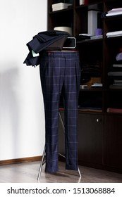 Bespoke checkered trousers on mannequin in atelier