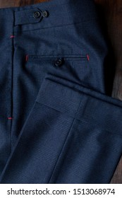 Bespoke navy blue pants, details. Close-up view. Top view.
