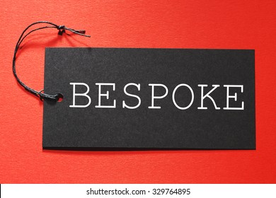 Bespoke text on a black tag on a red paper background