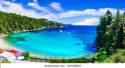 Best beaches of Alonissos island - tranquil organized Milia. Sporades islands of Greece