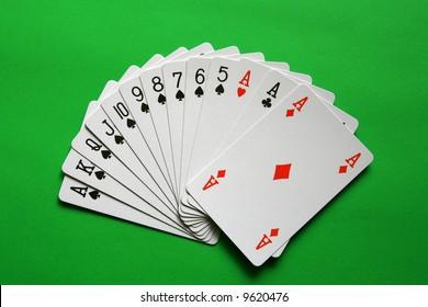 the best bridge cards (A,K,Q,J,10,9,8,7,6,5 spades, A heart, A diamond, A club)  background green,
