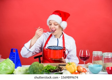 Best christmas recipes. Christmas dinner idea. Cooking for family. Try main meal. Healthy christmas holiday recipes. Easy ideas for christmas party. Woman chef santa hat cooking hold wooden spoons.
