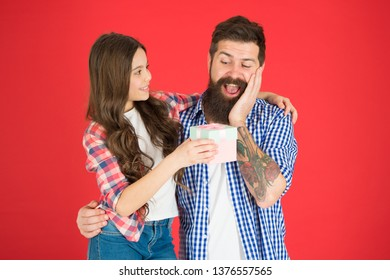 For best dad ever. Celebrate fathers day. Family values concept. Friendly relations. Father hipster and his daughter. Gift surprise. Man bearded father and cute little girl daughter on red background.