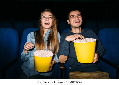 Best date entertainment in cinema. Young couple enjoying a movie at the cinema on their date night.
