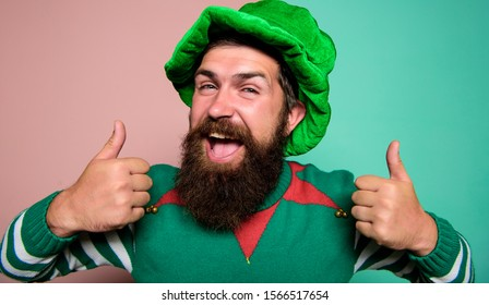 Best day ever. St Patricks day. Hipster with beard wearing green party costume thumbs up. Cheerful man celebrate holiday. Christmas elf. Elf concept. Happy celebration. Bearded elf. Winter carnival.