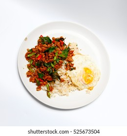Best food,pork and basil with rice and egg on with background.