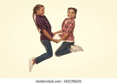 Best friend dressing. Girls friends wear similar outfits have same hairstyle kanekalon braids white background. Sisters family look outfit. Dress similar with best friend. Dress to match your friend.