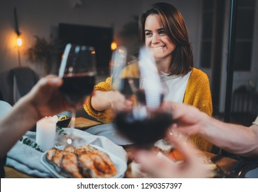 Best friends dining together at home clinking with glasses of red wine, cozy atmosphere, group of people celebrating birthday party at home, Family Dinner Celebrate Friendship Concept