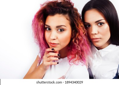 best friends diverse races teenage girls together having fun, asian and african , posing emotional on white background, lifestyle people concept