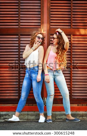 e7a6ce0f0e Best friends are dressed in the style of pin-up. Girls laugh. The