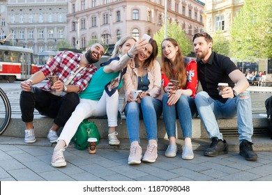 best friends enjoy abandon lifestyle in the city streets taking selfie having coffee