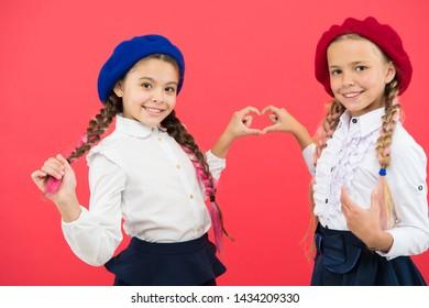 Best friends. Fancy style. School friendship. Schoolgirls wear formal school uniform. Children beautiful girls long braided hair. Little girls with braids ready for school. School fashion concept.