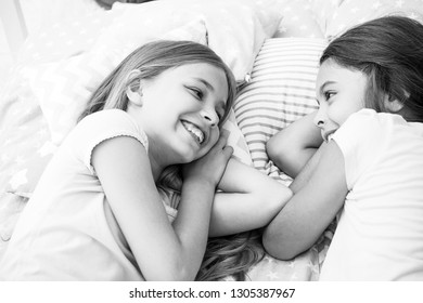 Best friends forever. Girls relaxing on bed. Slumber party concept. Girls just want to have fun. Invite friend for sleepover. Consider theme slumber party. Slumber party timeless childhood tradition.