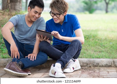 Best friends hanging out together watching stuff on the tablet screen