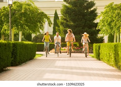 Best friends having fun on bikes. Group of young active students riding bicycles outside. People, leisure and lifestyle.