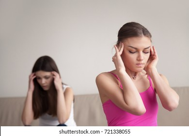 Best friends having time out after arguing. Girlfriends have headache after heated argument. Problems and conflict in relationships between close friends, siblings have personal differences concept.