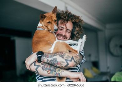 Best friends hugging dog and hipster