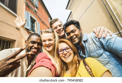 Best friends multiracial people taking selfie outdoor - Happy friendship concept with young students having fun together - Peace love against racism - International exchange experience - Warm filter