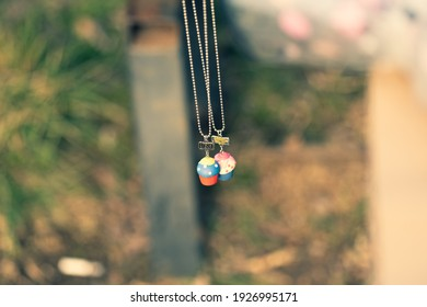 Best friends necklace shoot outside in a summer day closeup. Selective Focus