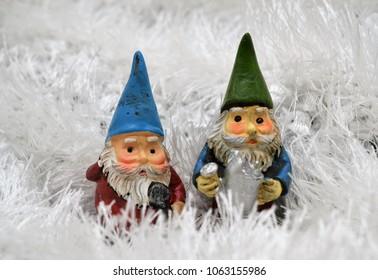 Best friends old men garden gnomes in snowy enchanted landscape