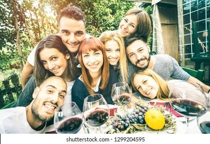 Best friends taking selfie at lunch party with serene faces - Happy youth concept with young people having fun together drinking wine - Cheer and friendship at grape harvest time - Bright retro filter