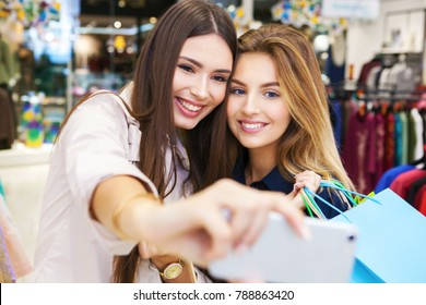 Best friends taking selfie while out on a shopping spree.