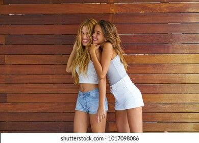 Best friends teen girls happy having fun together hug